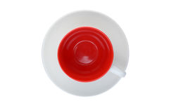 Isolated red cup on a saucer. Isolated top view of an empty red cup on a saucer Stock Photo