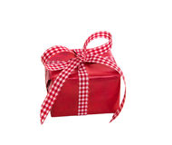 Isolated red gift box with a checked ribbon on a white backgroun Stock Photo