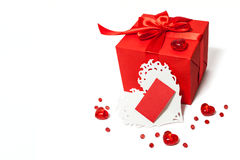 Isolated red gift box with Valentines card Stock Images