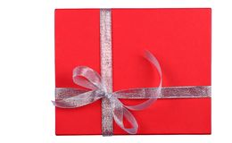 Isolated red gift box on white background. royalty free stock image