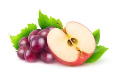 Isolated red grapes and apple stock photography