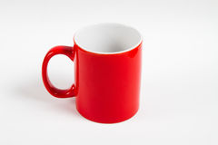 Isolated red mug. Ove withe background royalty free stock photo