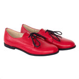 Isolated red Oxford shoe. Royalty Free Stock Photo
