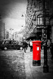 Isolated Red Post Box On a Busy London Street Stock Photography