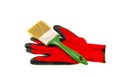 Isolated red protective glove and brush tool Royalty Free Stock Photos