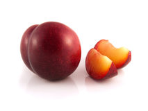 Isolated red ripe plum with two slices. Fresh diet fruit. Healthy fruit with vitamins Stock Photography