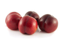 Isolated red ripe plums on a white background. Fresh diet fruit. Healthy fruit with vitamins Royalty Free Stock Photos