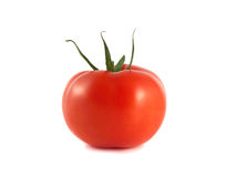 Isolated red ripe tomato on a white background. Healthy vegetable Royalty Free Stock Photo