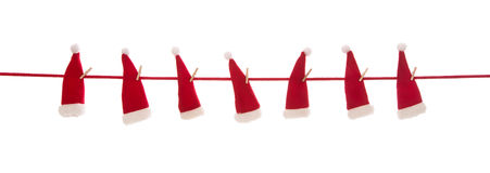 Isolated red santa hats on white background for christmas decora Royalty Free Stock Images