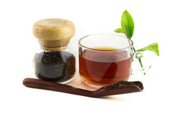 Isolated of red tea. Isolated cup of red tea with spoon and tea leaf Stock Images