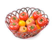 Isolated red tomatoes, apple and orange Royalty Free Stock Photos
