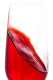 Isolated of red water in wine glass is motion on white backgroun Royalty Free Stock Photo