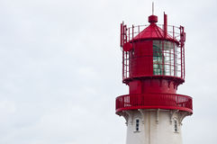 Isolated red and white lighthouse. Cropped showing the top Royalty Free Stock Image