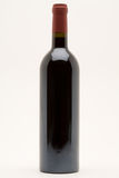 Isolated red wine bottle. On a white background royalty free stock photo