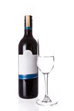 Isolated of the red wine bottle with glass on white background Royalty Free Stock Images