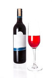 Isolated of the red wine bottle with glass on white background Royalty Free Stock Photo