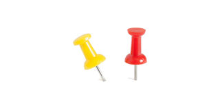 Isolated red and yellow push pins in white background Stock Photos