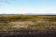 Isolated refuge in Iceland. A small red-roofed hut lost in the middle of a desert landscape in Iceland`s wilderness Royalty Free Stock Image