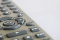 Isolated remote control with the word. Enter on the white background Stock Image
