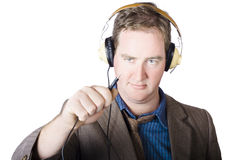 Isolated retro man about to plugin stereo headphones Stock Photo