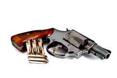 Isolated revolver handgun with bullet Royalty Free Stock Images