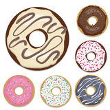 Isolated ring shaped set of donuts placed on white background. Set of 6 donuts with different flavor: strawberry, blueberry, white glazed, colorful sprinkle with Stock Photo