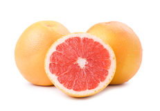 Isolated ripe grapefruit and slice Royalty Free Stock Images
