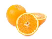 Isolated ripe orange fruit and slice Stock Photos