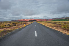 Isolated road and mountain landscape at Iceland Stock Photography