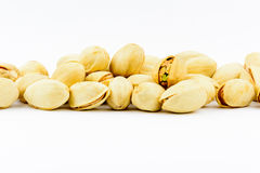 Isolated roasted pistachios nuts on a white background Stock Image