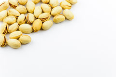 Isolated roasted pistachios nuts on a white background Royalty Free Stock Image