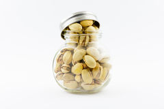 Isolated roasted pistachios nuts on a white background Stock Images