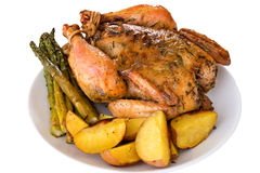 Isolated roasted whole chicken on a plate stock photo