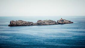 Isolated rocks in the Adriatic Sea near Dubrovnik Royalty Free Stock Images