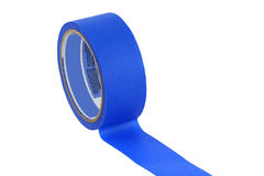 Isolated roll of blue painters tape Royalty Free Stock Images