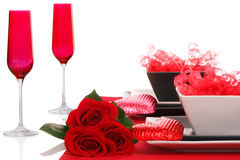 Isolated; Romantic Modern B&W Table Setting. Isolated; Romantic Modern Black & White Table Setting ~ Red Champagne Flutes with Fresh Red Roses Royalty Free Stock Photo