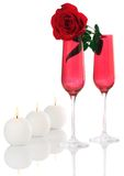 Isolated; Romantic Red Champagne Flutes with Rose. Isolated; Romantic Red Champagne Flutes with Fresh Red Rose and White Candles Stock Photo