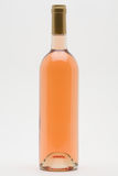 Isolated rose wine bottle. On a white background royalty free stock images