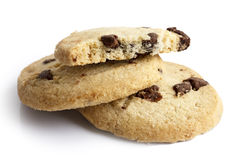 Isolated round chocolate chip shortbread biscuits. Broken piece. Royalty Free Stock Photography