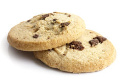 Isolated round chocolate chip shortbread biscuits. Broken piece. Royalty Free Stock Photos