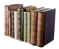 Isolated row with old books. Isolated row of antique books on white background Stock Photos