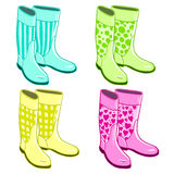 Isolated rubber gumboots. Set of bright neon gumboots. Isolated rubber shoes elements Stock Illustration