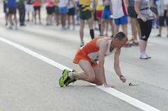 Isolated runner. Man touching the ground before the 2013 Peoria Marathon Royalty Free Stock Photo
