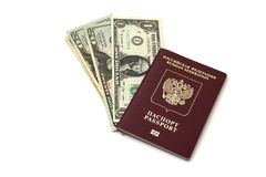 Isolated Russian passport and a pack of American dollars on white background royalty free stock image