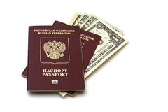 Isolated Russian passports and a pack of American dollars on white background royalty free stock photography