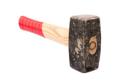 Isolated rusty hammer. With red wooden handle on white background Stock Photos
