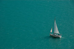 Isolated Sailboat On A Blue Lake Background Royalty Free Stock Photo
