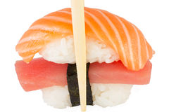 Isolated salmon and tuna nigiri in chopsticks and white background Royalty Free Stock Photography