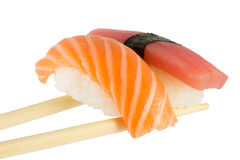 Isolated salmon and tuna nigiri on chopsticks and white background Stock Images