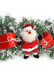 Isolated Santa Claus. Santa Claus with red gift boxes isolated on white Stock Photo